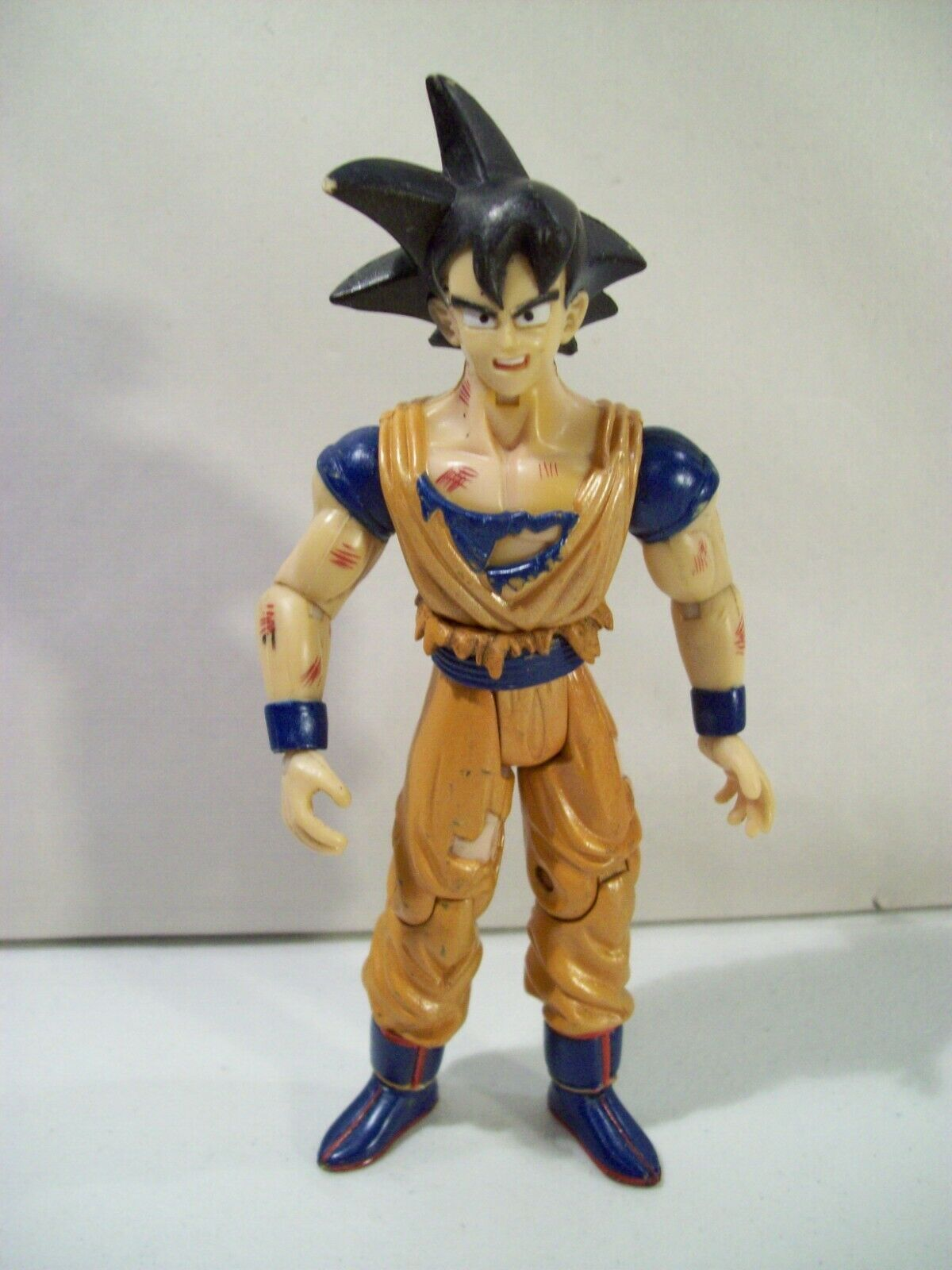 Primary image for DRAGONBALL Z FUSION SAGA BATTLE DAMAGED GOKU ACTION FIGURE 2003 JAKKS