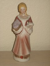 Flambro - Porcelain Lady in Two Tone Brown Dress Carrying Basket of Grapes - $9.85