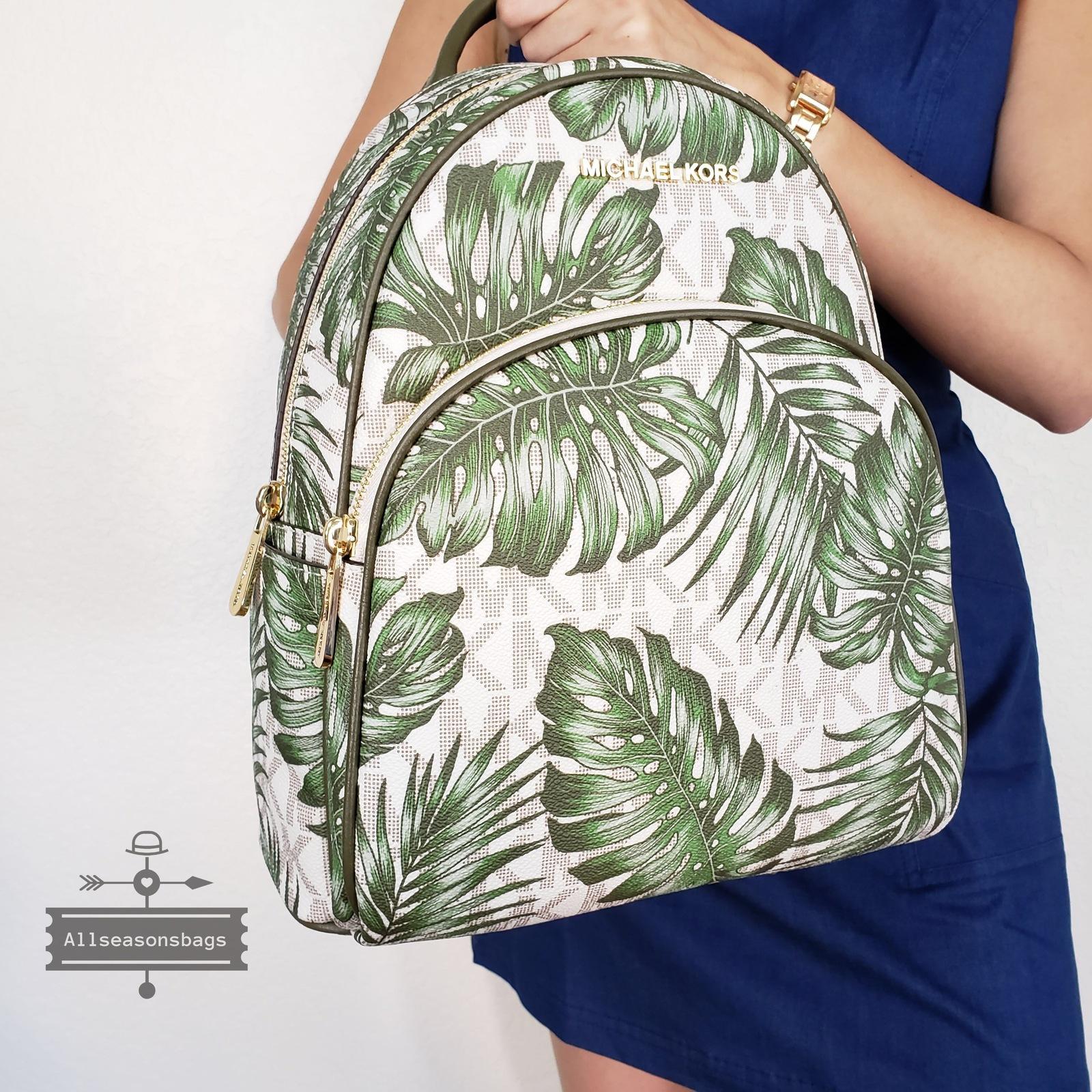 09b3ba102696 NWT Michael Kors palm Leaf Print PVC Abbey Medium backpack Olive Vanilla Bag