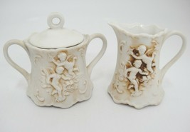 Vintage Lefton Miniature Sugar Bowl with Lid and Creamer w Embossed Cherubs - $19.79