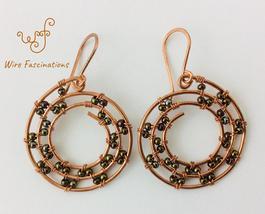 Handmade Copper Earrings Spiral Sun Pattern Beading - $30.00