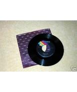 Island Girl / Suger on the Floor Elton John 1975 - $2.93
