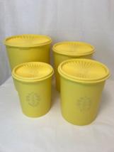 Vintage Set of 4 Servalier type Tupperware canisters.   - $95.00