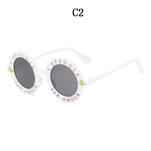84b102eaa4ed2 BOYSEEN Retro Round Sunglasses English Letters Little Bee Sun Glasses Men  Women