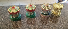 LOT OF 4 ASSORTED CAROUSEL CHRISTMAS ORNAMENTS - $24.74