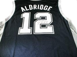 LAMARCUS ALDRIDGE / AUTOGRAPHED SAN ANOTNIO SPURS BLACK PRO STYLE JERSEY / COA