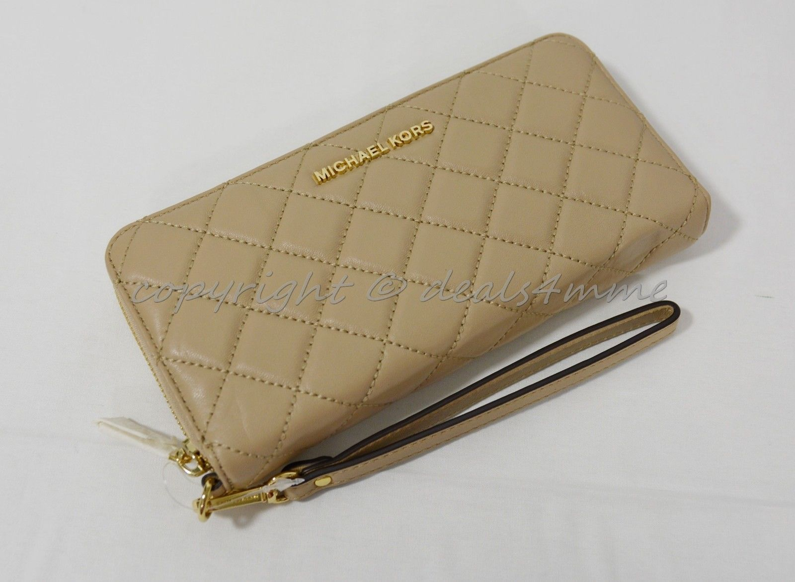 59ef4c6a8392 S l1600. S l1600. Previous. Michael Kors Quilted Leather Continental Zip  Around Wallet Wristlet ...