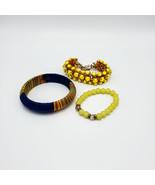 Three Bracelets in Yellow Orange Blue - $20.00