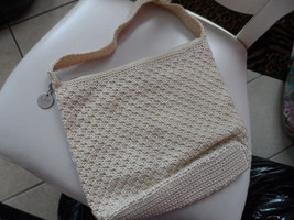 cream colored woven handbag from The Sak - $8.99