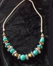 beaded turquoise and gold colored necklace: it's never too late to find your isl - $24.99