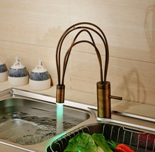 Juno Contemporary Deck Mounted Brass Single Lever Swivel Spout Faucet - $212.85+
