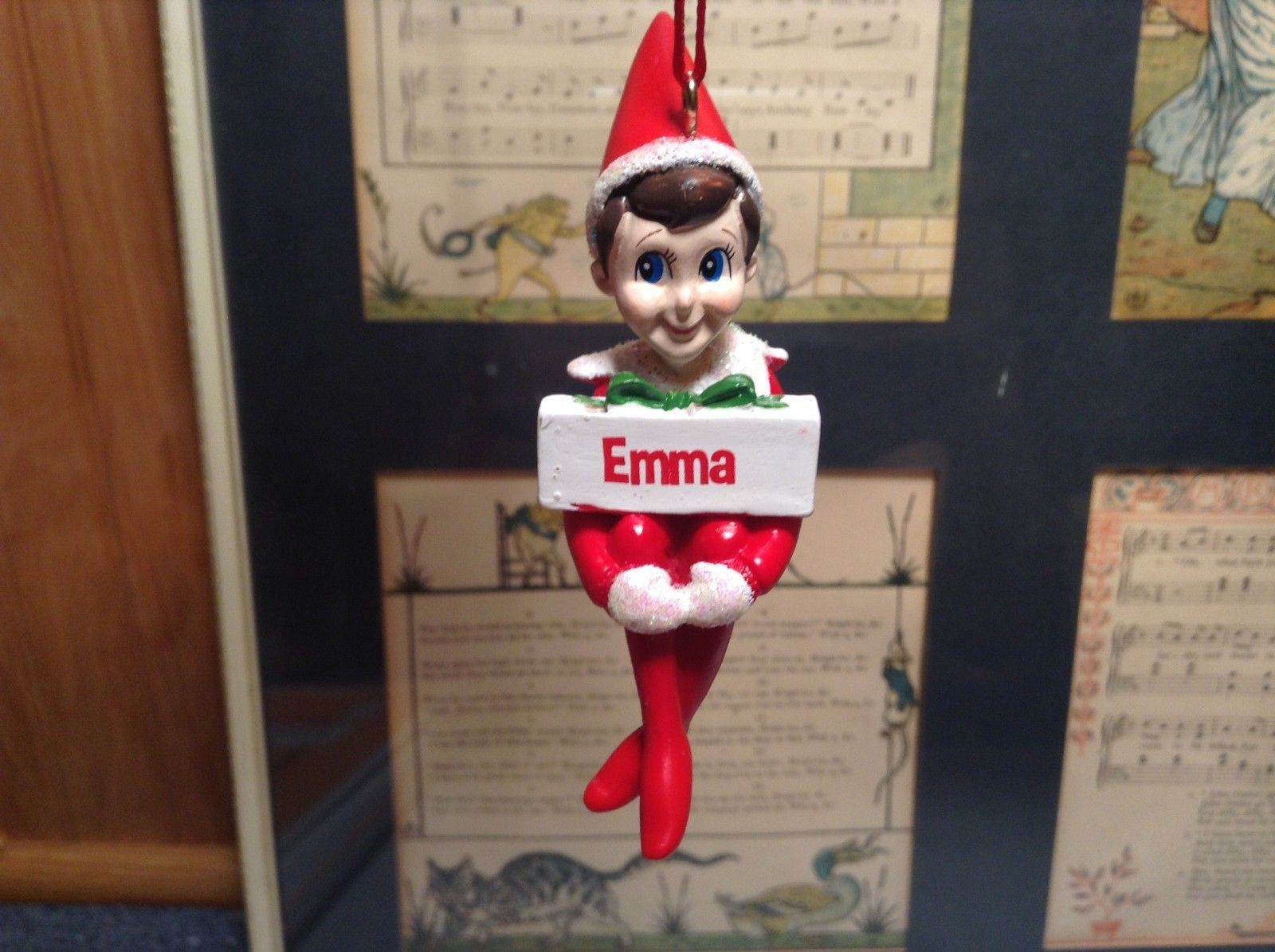 Dept 56 - Elf on the Shelf - Emma  banner Christmas Ornament