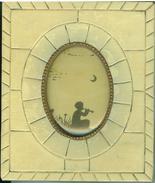 Vintage Silhoette Boy w/ flute celluloid type frame - $4.00