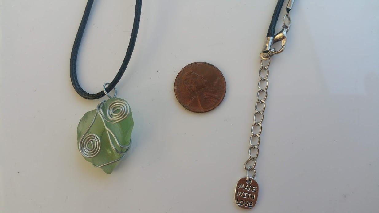 Ocean Gift necklace: Pale green Estonian sea glass, silver wire wrap spirals