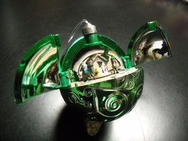Mr Christmas Christmas Ornament Pop Open Green Silver Sphere Musical Win... - $12.99