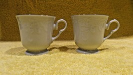 Golden Legacy Teacups Mugs White Gold Edge Embossed Lot of 2 FREE SHIPPING! - $25.73