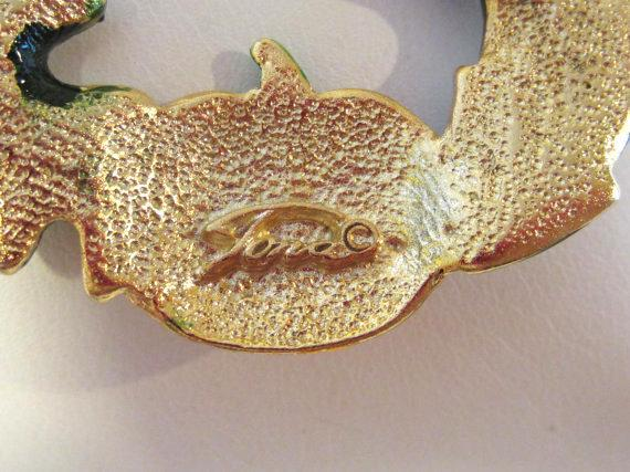 Vintage jewelry goldtone signed TONA enamel brooch