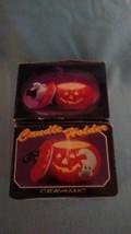 A  HALLOWEEN SET OF CERAMIC PUMPKIN CANDLE HOLDERS - $5.93