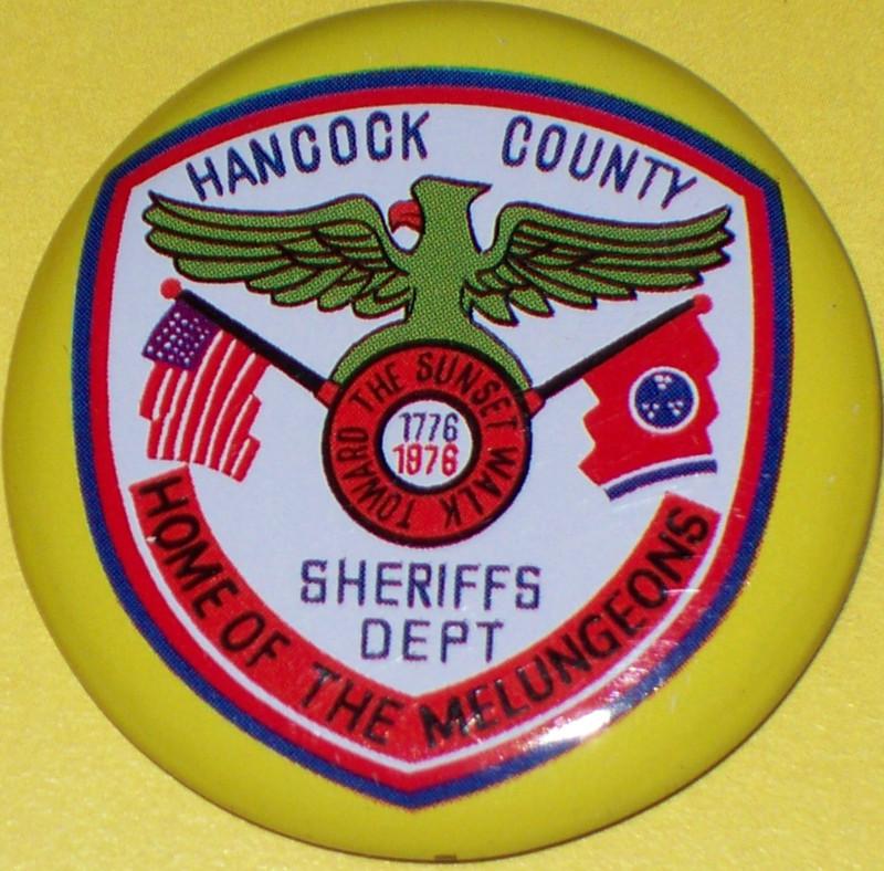 Hancock tin badge 002