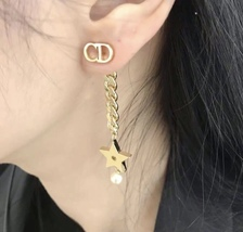 Authentic Christian Dior 2019 CC LOGO CHAIN STAR DANGLE TRIBALE EARRING  image 12