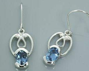 Oval cut london blue topaz dangling earrings