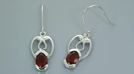 Oval cut garnet dangling earrings sterling silver received