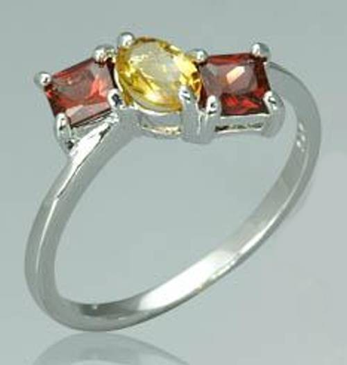 Oval citrine princess garnet three stone ring