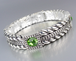 Designer Style Silver Cables Green Crystals Stretch Bracelet - $9.99