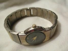 Geneva Wristwatch Round Black Face Gold & Silver Toned Rhinestones - $29.00
