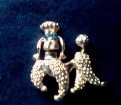 Poodle Dog With Sparkling Glass Blue Eyes Brooch Pin Back - $10.85