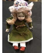 Porcelain Doll 9 Inch Antique Style With Bendable Arms And Legs Green Dress - $8.04