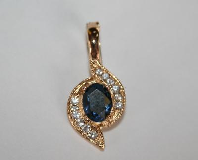 Signed Roman Goldtone Simulated Blue Sapphire Clear Rhinestone Pendant  J282