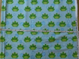 Fabric Flannel Green Frogs on Blue background Sold by the half yard BHY - $3.47