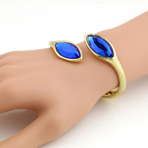 UE-Stunning Designer Gold Tone Bangle Bracelet With Cobalt Blue Faux Sap... - $14.99