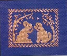 Spring Silhouette Bunny Tells Puppy cross stitch chart w/charm Handblessings - $5.00