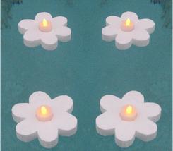 Tea Lights LED Flickering Floating Daisy.  Long lasting Lithium Batterie... - $11.00