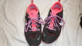 pink and black nike free tr fit4 size 6 - $22.76