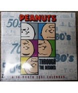 Peanuts Snoopy 2001 Throughout the Decades wall calendar - M - $4.99