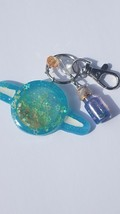 blue green resin planet shaker keychain - $15.00