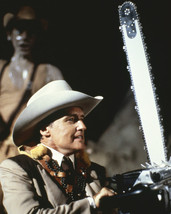 The Texas Chainsaw Massacre 2 Dennis Hopper with huge chainsaw 8x10 Photo - $7.99