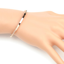 UE- Stylish Rose Tone Designer Twisted Bangle Bracelet With Trendy Bar Design - $13.99