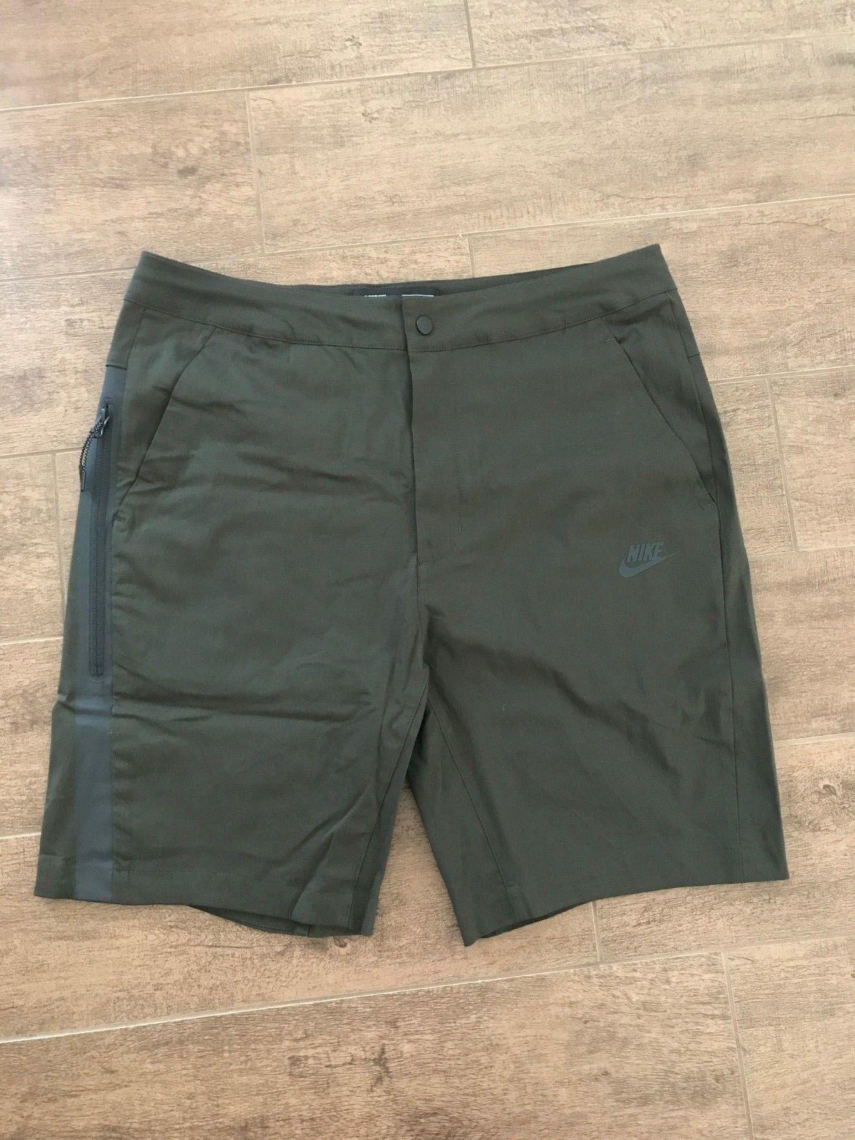 Men/'s Woven Shorts Nike Sportswear 927925 355 Green  SZ  34