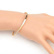 UE- Stylish Gold Tone Designer Twisted Bangle Bracelet With Trendy Bar D... - $13.99