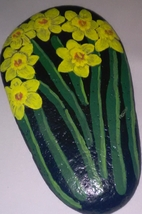 Daffodils painted on a rock