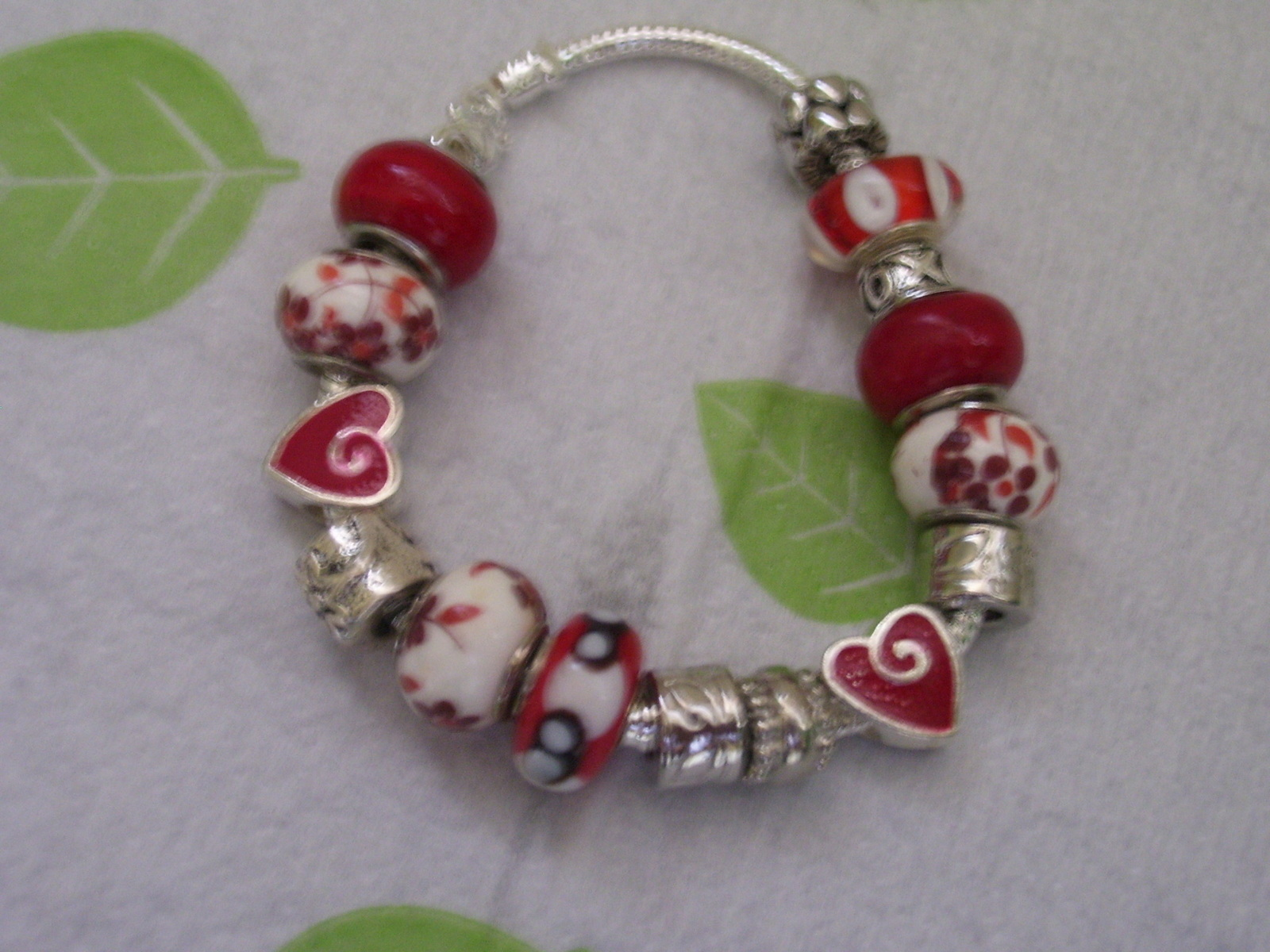 Lovely Red and White Charmed Silver Bracelet