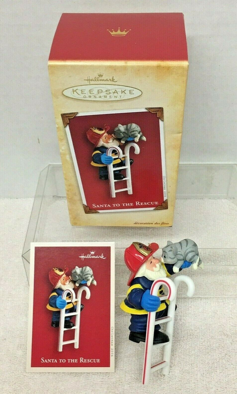 Primary image for 2004 Santa to the Rescue Hallmark Christmas Tree Ornament MIB w Price Tag