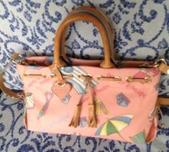 Dooney and Bourke Miami Print tassel handbag in pink - $78.00