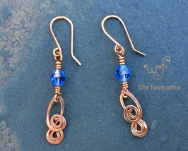 Handmade copper earrings: blue bicone crystal with double spiral dangle - $25.00
