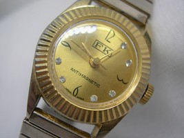 L69, FK Anti-mag Ladies Wristwatch, Gold Tone Face and Flex Band, wb - $13.79
