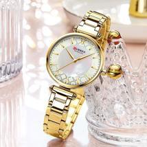 CURREN Women's elegant, thin quartz wristwatch with stainless steel strap.M-9072 - $37.99
